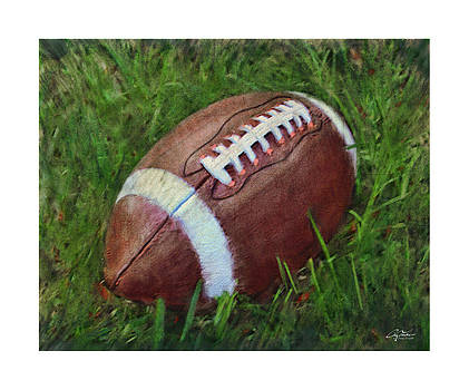 Football on Field by Craig Tinder