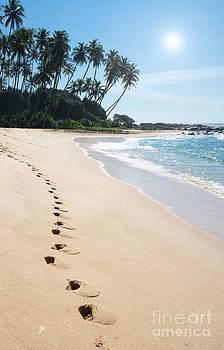Footprints on paradise beach by Christina Rahm