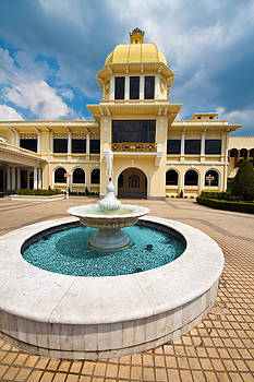 Fountain in front a vintage mansion by Calvin Chan