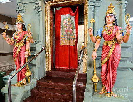 Four-armed deities guard the inner sanctum of a Hindu temple by David Hill