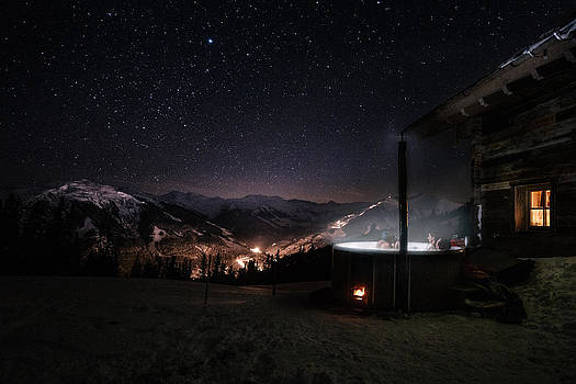 Friends In Jacuzzi In Snowcovered Mountain Landscape Under Dark  by Leander Nardin