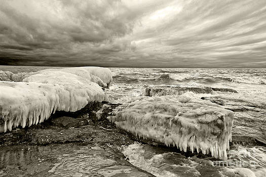 Frozen seascape under stormy skies by Alexandr  Malyshev