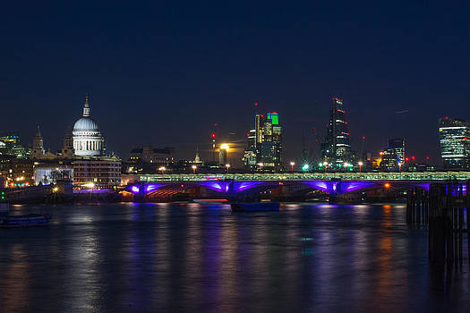 Full moon rise behind St Pauls by Andrew Lalchan