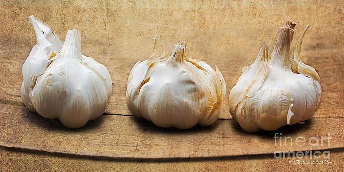 Barbara McMahon - Garlic on Old Barrel Board