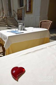 Glass hearshape on a restaurant table by Sami Sarkis