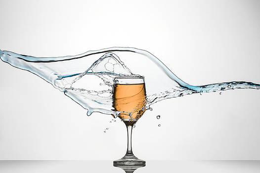 Glass of White Wine with splash. by Andy Astbury