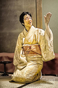 David Hill - Golden Glow - Japanese lady in traditional kimono explains the tea ceremony