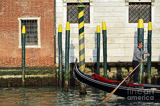 Gondola by buildings on Grand canal by Sami Sarkis