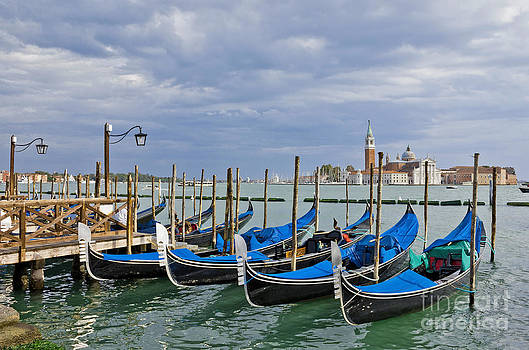 Gondolas near Piazza San Marco in Venice  by Kiril Stanchev