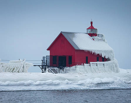Grand Haven Lighthouse encased in ice by Kimberly Kotzian