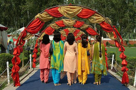 Devinder Sangha - Group of women walking on carpet