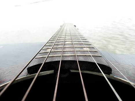 Guitar and water by Daniel Chowdhury