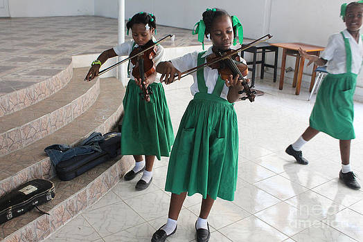 Haitian girls play violins by Jim Wright