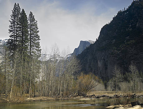Half Dome and the Merced river in winter by Richard Berry