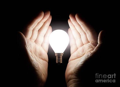 Simon Bratt Photography LRPS - Hands holding light bulb