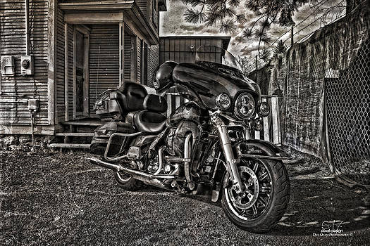 Harley parked by Dan Quam