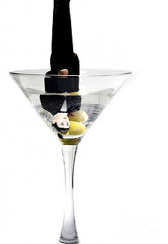 Heads down into the martini glass.It was a very bad date by Linda Matlow