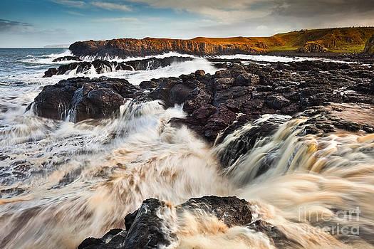 High Tide at Dunseverick Waterfall by Derek Smyth