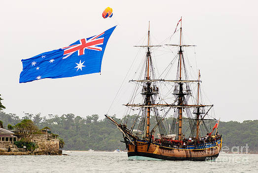 David Hill - HM Bark Endeavour - a replica - with large Australian flag