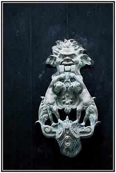 Pedro Cardona Llambias - hobgoblin in the door knocker of a Mahon streen in Menorca - Call if you