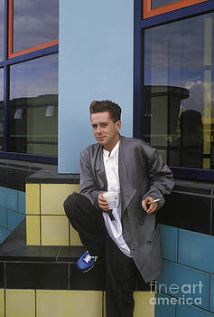 Holly Johnson blue shoe portrait by Homer Sykes