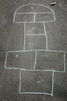 Hopscotch game outline drawn in chalk on driveway by Rob Huntley