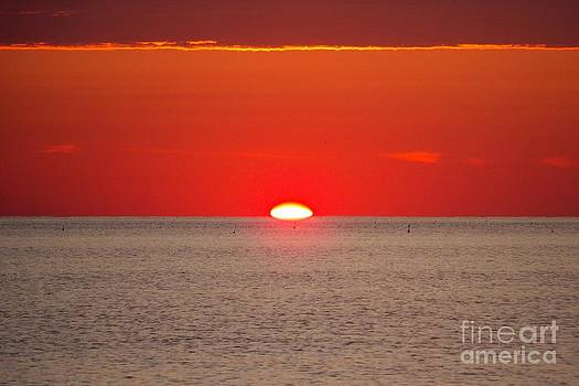 Hot Sun Seems To Melt Into The Sea by Eunice Miller