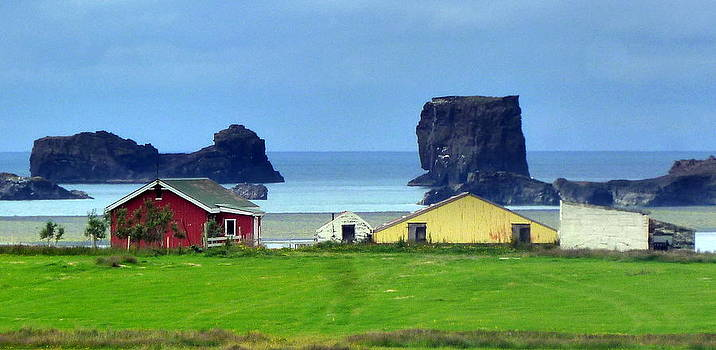 Houses and ocean  by Halldor  Sigurdsson