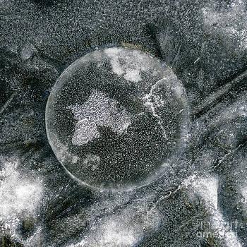 Steven Ralser - ice fishing hole 17