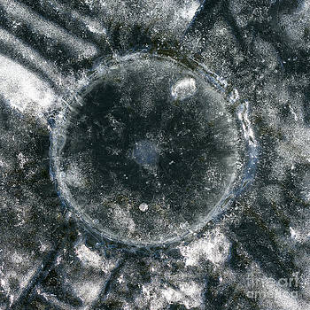 Steven Ralser - ice fishing hole 18