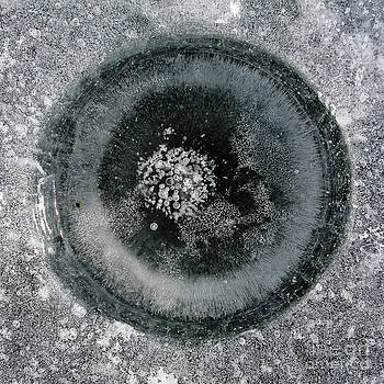 Steven Ralser - ice fishing hole 9