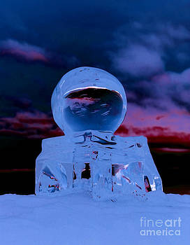 Ice globe and firey sunset by Rosemary Calvert