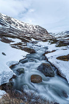 Ice Water Flowing Down The Jotunheimen National Park by Alex Galiano