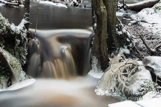 Icy stream by Markus Hovikoski