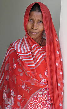 Indian women in red by Russell Smidt