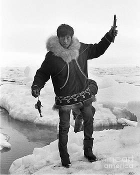 California Views Archives Mr Pat Hathaway Archives - Inuit boy Ice Fishing using a niksik  Barrow Alaska July 1969