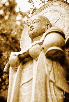 Japanese statue - Jizo - guardian of children in Japan by David Hill