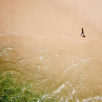 Jogger on Tallow Beach. Byron Bay. Australia. by Rob Huntley