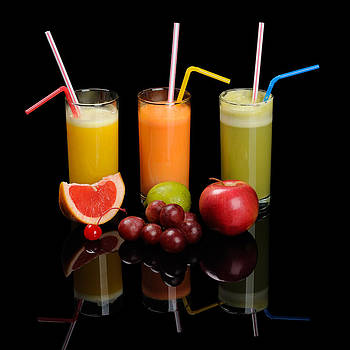 Juices on black reflecting background by Konstantin Gushcha