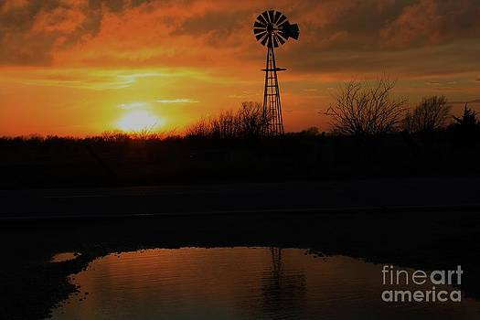 Kansas Blaze Orange sunset with Windmill and Water reflection by Robert D  Brozek