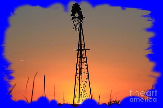 Kansas Windmill Framed Orange Silhouette In Blue by Robert D  Brozek
