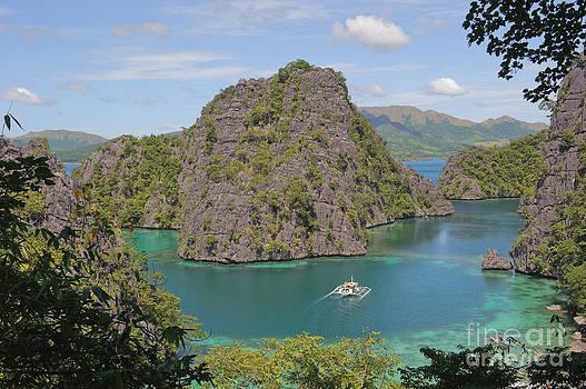 Kayangan lake or blue lagoon by Konstantin Kalishko
