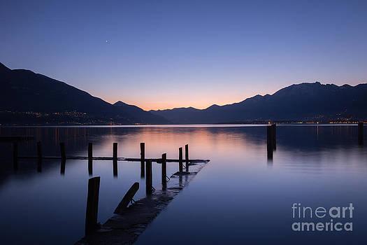 Lake at sunset by Maurizio Bacciarini