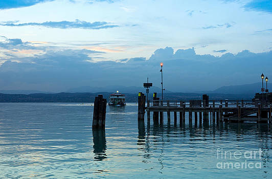 Lake Garda Pier and the Last Ferry for the day by Kiril Stanchev