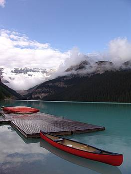 Calm Canoeing Morning - Lake Louise, Banff, Alberta by Ian Mcadie