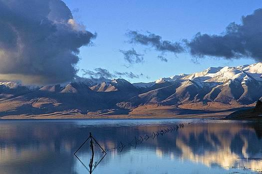 Lake Manasarovar at sunrise by Xanat Flores
