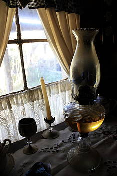 Lantern in the window. by Ian  Ramsay