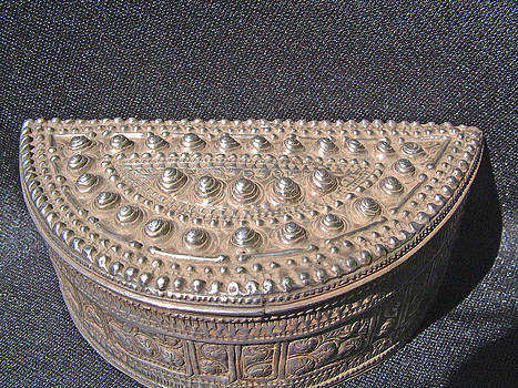 Laotian silver betel nuts container in semi-circle shape by Laotian silversmith
