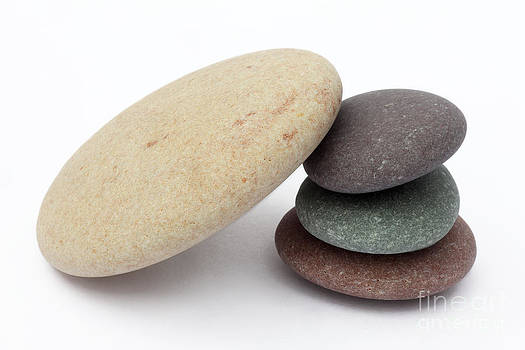 Large pebble leans on small ones by Rosemary Calvert