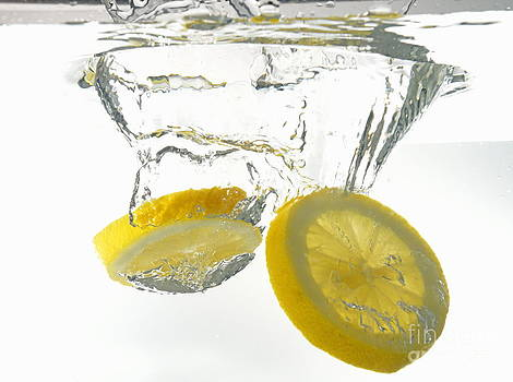 Lemon slices underwater by Sami Sarkis